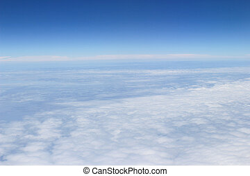 blue sky high view from airplane clouds shapes - the blue...