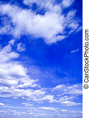 The blue sky and beautiful white clouds.