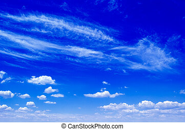 The blue sky and clouds.