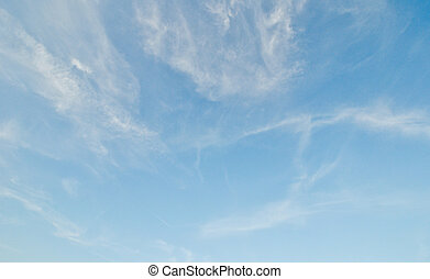 The blue sky with white plumose clouds