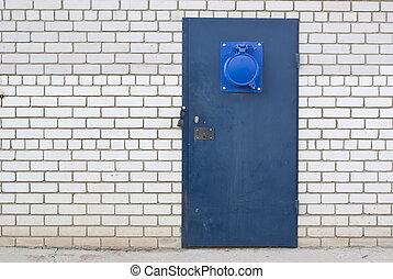 blue steel door in the brick white