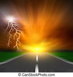 The blurred asphalt road with storm lightning on  sky