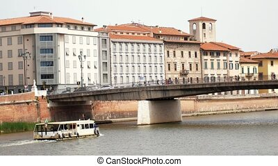 The boat floats on the river and goes under the bridge -...