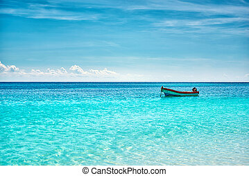 The boat in the Caribbean Sea on a sunny day.