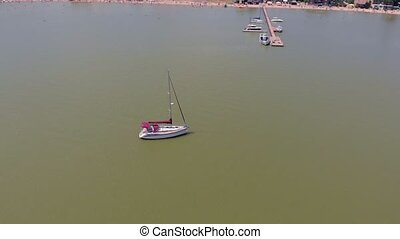 The boat is at sea. Aerial video - A boat stands at sea on a...