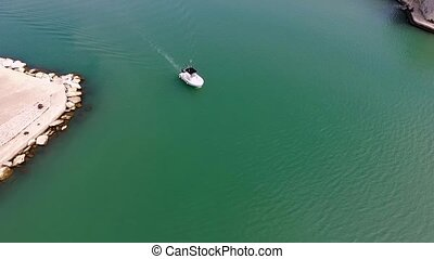 The boat is floating in the sea View from the drone