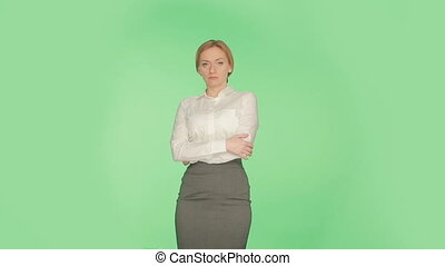 the body language of a woman on a green background. arms....