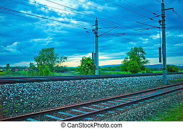 body of a railway track with dark clouds