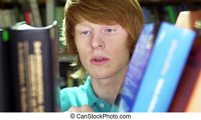 The Book I Need - Student with freckles taking a necessary...