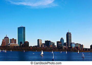 Boston, Massachusetts skyline with sailboats in foreground