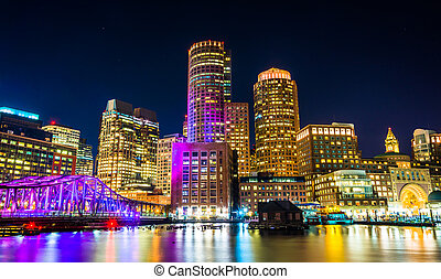 The Boston skyline and Fort Point Channel at night from Fan Pier