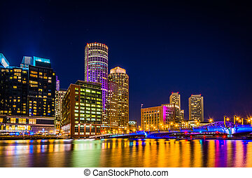 The Boston skyline at night, seen from Fort Point, Boston, Massa
