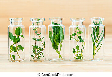 The bottle of essential oil with herbs rosemary