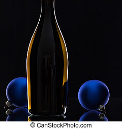 The bottle of red wine and Christmas decoration