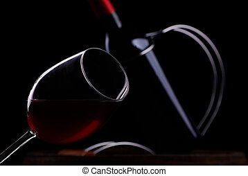 The bottleand glass  of red wine