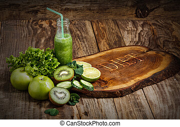 The bottles with fresh vegetable juices on wooden table