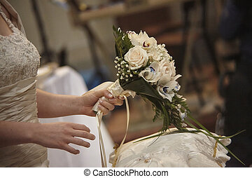 The bouquet in the hands of the bride