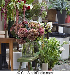 the Bouquets of a large red hydrangea for sale at the entrance to the store