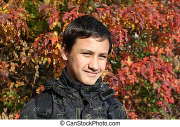 The boy against fall background