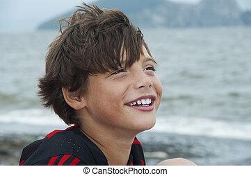 boy against the sea