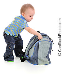 The boy and backpack. - The little boy looking through...
