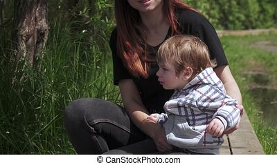 The boy cries and his mother