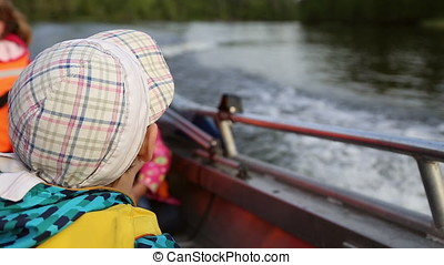 The boy floating on a boat