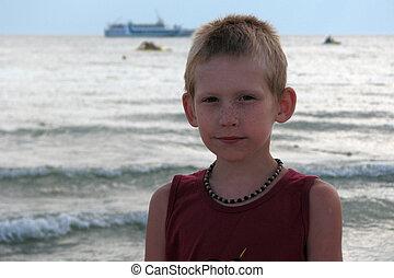 the boy goes on the seashore