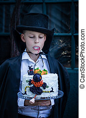 The boy holding a cake