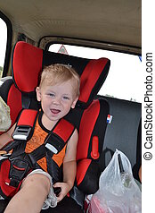 The boy in an automobile chair
