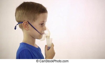 The boy in the mask the inhaler is treated, he breathes in...