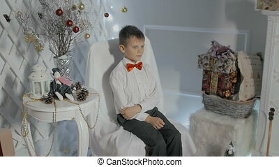the boy in the red bow tie and shirt posing