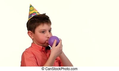The boy in the red shirt inflates a balloon purple, slow motion, white background