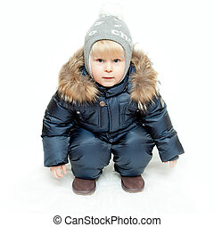 The boy in winter overalls