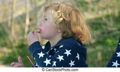 The boy is eating ice cream