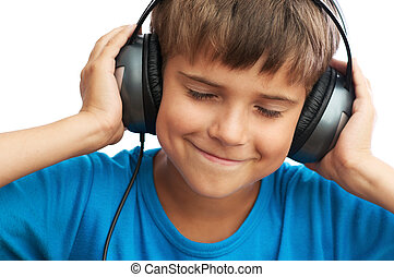The boy is listening to music
