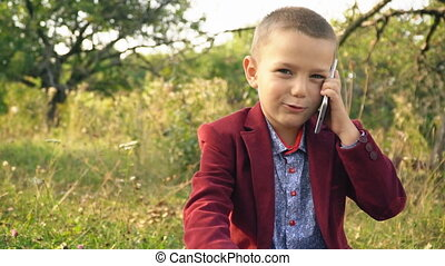 the boy is talking on the phone