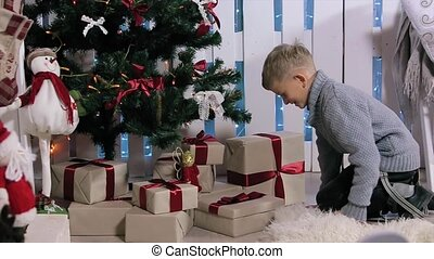 The boy ran to the tree, extracts from phone boxes, white Room with Fireplace and Christmas Tree, Medium
