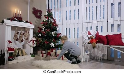 The boy ran to the tree, extracts from phone boxes, white Room with Fireplace and Christmas Tree