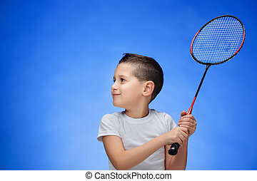 The boy with badminton rackets outdoors - Boy with badminton...