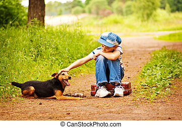 The boy with his dog in the forest