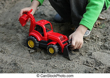The boy with The car-excavator.