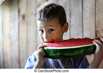 The boy with water-melon