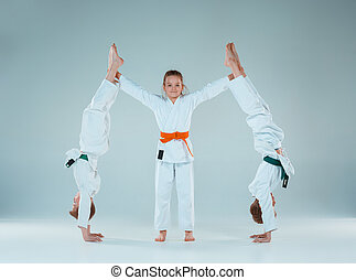 The boys fighting at Aikido training in martial arts school. Healthy lifestyle and sports concept