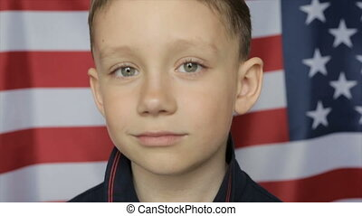 The boy's portrait against the background of the American banner. Close up