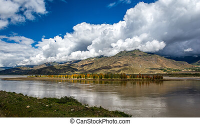 Brahmaputra river - The Brahmaputra river with cloudy sky in...