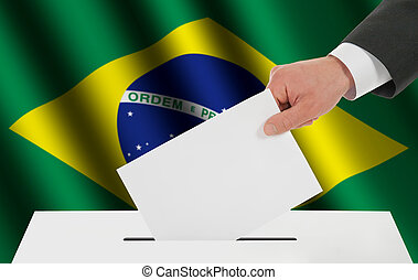 The Brazilian flag and the hand with the bulletin about the ballot box