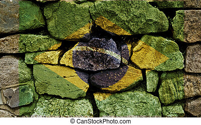 The Brazilian Flag painted on to a stone wall.
