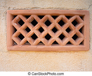 The Brick wall with old ventilation plate