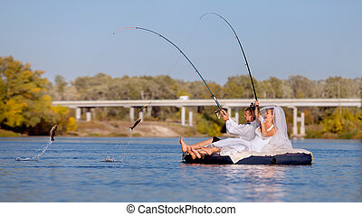 The bride and groom are fishing - Bride and groom are...
